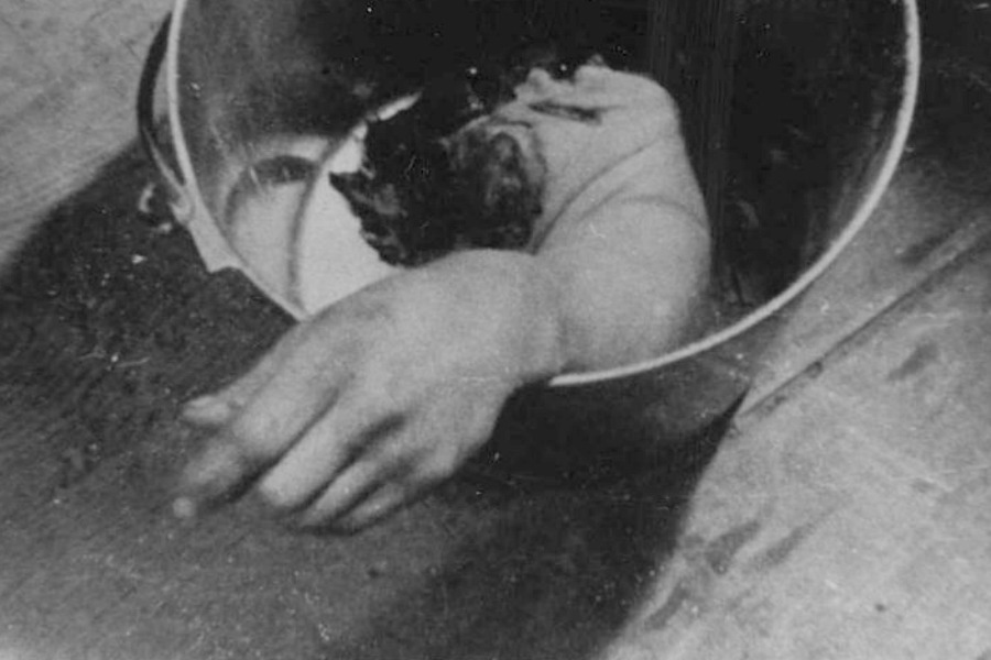 Bucket on floor with arm in it, hand extending over top of bucket. On back: 8055 M.A.S.H. [Mobile Army Surgical Hospital?], 1950- Wikimedia Commons